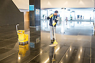 A cleaner puts the finishing touches to the inside of the stadium before the 2014 FIFA World Cup match at Arena Corinthians, Sao Paulo<br /> Picture by Andrew Tobin/Focus Images Ltd +44 7710 761829<br /> 19/06/2014