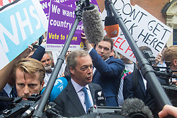 "Smith Square, Westminster, London, June 16th 2016. UKIP leader Nigel Farage launches his ""biggest ever"" advertising campaign as Leave and Remain enter their last week of campaigning before the EU referendum on June 23rd. PICTURED: Nigel Farage speaks to the media as Remain campaigners get their posters in front of the cameras."