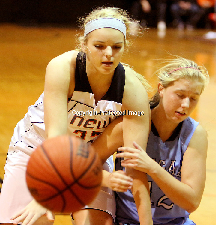 New Hanover's Sarah Jonkheer and Hoggard's Julia Buehler battle for a loose ball. (Jason A. Frizzelle)