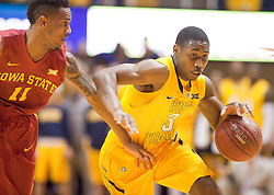 West Virginia Mountaineers guard Juwan Staten (3) drives to the basket against the Iowa State Cyclones during the first half at the WVU Coliseum.