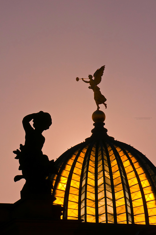 """Statue of an angel holding the """"Trumpet of Fame"""" atop the glass dome known as the Lemon Squeezer (Zitronenpresse) on the Kunstakademie (Art Academy), Dresden, Saxony, Germany"""