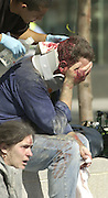 New York City Police officers are treated at a triage center at the  Jersey City waterfront after both the World Trade Towers collapsed on 09/11/01. Victims were transported by ferry across the Hudson.