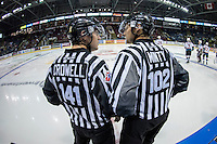 KELOWNA, CANADA - SEPTEMBER 5: Linesman Dustin Minty and Kevin Crowell stand on the ice between the benches of the Kelowna Rockets and the Prince George Cougars on September 5, 2015 during the first pre-season game at Prospera Place in Kelowna, British Columbia, Canada.  (Photo by Marissa Baecker/Shoot the Breeze)  *** Local Caption *** Dustin Minty; Kevin Crowell;
