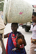 Africa, Tanzania, Frontier Market selling straw baskets