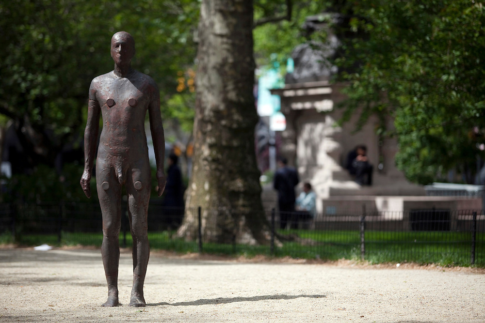 """British sculptor Antony Gormley has placed 31 figures of himself cast in iron and glass fibre on city pathways, pavements, rooftops and ledges of New York City. The exhibition, called """"Event Horizon""""  marks Gormley's United States public art debut -- a milestone for an artist whose work has garnered worldwide acclaim over the past 25 years.  Antony Gormley originally created Event Horizon for London's Hayward Gallery as part of the Blind Light exhibition in 2007."""