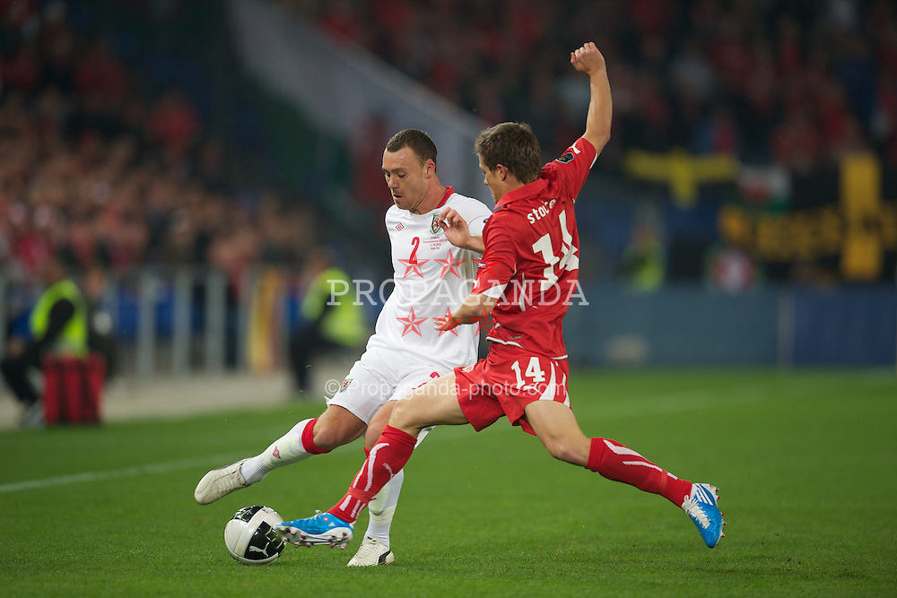 BASEL, SWITZERLAND - Tuesday, October 12, 2010: Wales' Darcy Blake in action against Switzerland's Valentin Stocker during the UEFA Euro 2012 qualifying Group G match at St. Jakob-Park. (Pic by David Rawcliffe/Propaganda)