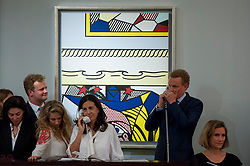 "© Licensed to London News Pictures. 28/06/2017. London, UK. ""Two Paintings with Dado"", 1983, by Roy Lichtenstein sold for a hammer price of GBP2.8m (estimate GBP2.4-3m) at Sotheby's Contemporary Art evening sale in New Bond Street, which featured pioneering works from the Pop Art genre. Photo credit : Stephen Chung/LNP"