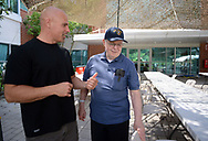Ken Keene Jr. (left) and his father Ken Keene Sr. walk on the patio as they chat about living with early onset dementia Thursday, August 31, 2017 at the Delaware Valley Veterans Home in Philadelphia, Pennsylvania. (WILLIAM THOMAS CAIN / For The Philadelphia Inquirer)