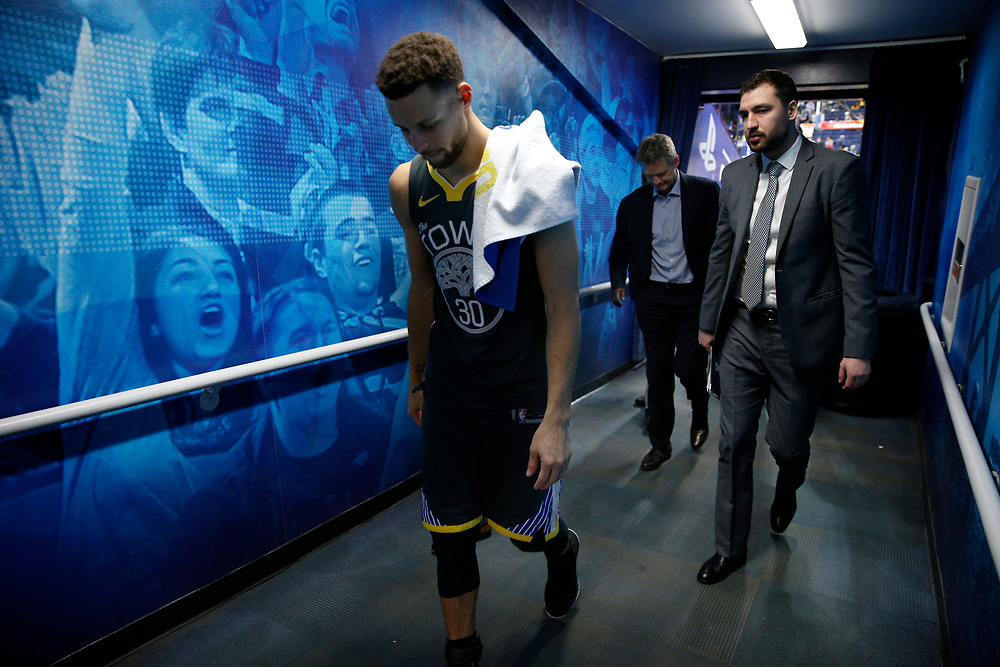From left: Golden State Warriors guard Stephen Curry (30) and Golden State Warriors head coach Steve Kerr head to the locker room following the NBA game between the Warriors and Oklahoma City Thunder at Oracle Arena, Tuesday, Feb. 6, 2018, in Oakland, Calif. The Warriors lost 105-125.