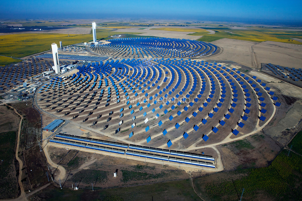 The PS10 and PS20 solar tower plants sit at Sanlucar la Mayor outside Seville, Spain. The solar tower plant, the first commercial solar tower in the world, by the Spanish company Solucar (Abengoa), can provide electricity for up to 6,000 homes. Solucar (Abengoa) plans to build a total of 9 solar towers over the next 7 years to provide electricity for an estimated 180,000 homes.