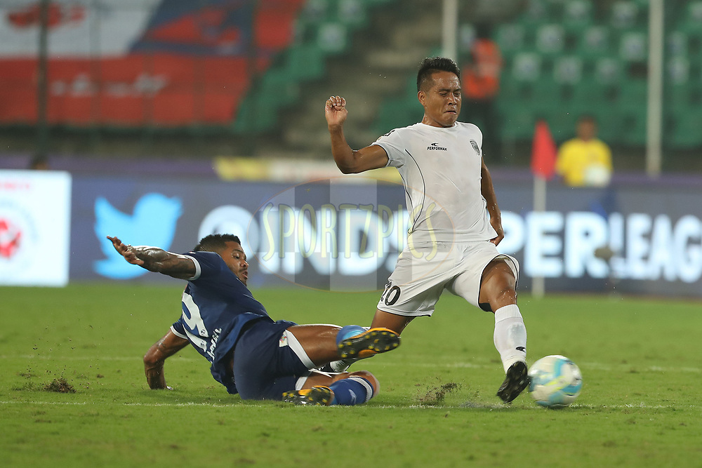 Raphael Augusto of Chennaiyin FC tackles Lalrindika Ralte of Northeast United FC during match 6 of the Hero Indian Super League between Chennaiyin FC and NorthEast United FC held at the Jawaharlal Nehru Stadium, Chennai, India on the 23rd November 2017<br /> <br /> Photo by: Ron Gaunt / ISL / SPORTZPICS