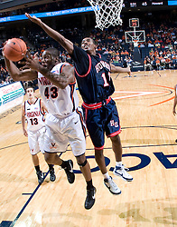 Virginia guard-forward Will Harris (43) grabs a rebound from Howard Bison forward Randy Hampton (10).  The Virginia Cavaliers men's basketball team faced the Howard Bison at the John Paul Jones Arena in Charlottesville, VA on November 14, 2007.