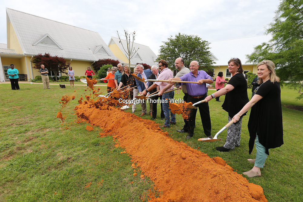The Executive Board o the Santuary Hospice House break ground on a new expansion Monday afternoon.