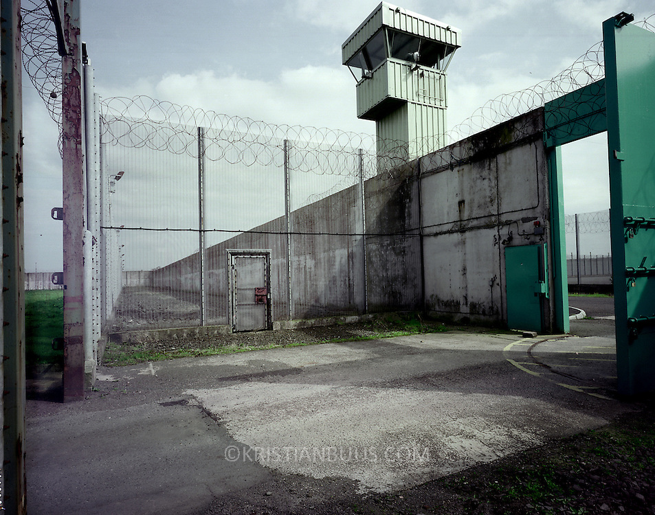 the Maze Prison, Northern Ireland..01.05.01.photo: Kristian Buus..Deep inside the Maze prison. The Maze prison is composed by 8 individual blocks all partitioned by several walls.  Each block can be seperately sealed off from a central controle room. Nobody has ever escaped by climbing the walls. The Maze Prison has been empty since late September 2000 after the Good Friday Peace Agreement meant all prisoners were released.  3 out the 8 H-blocks are still in operative condition, termed 'warm storage.