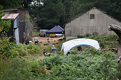 © Licensed to London News Pictures. 11/08/2020. Bisley, UK. A police tent covers an area where investigators are digging at Priest Lane Farm near Bisley in Surrey as part of an historic murder investigation. Surrey Police, supported by the British Army and specialist forensic teams are carrying out a dig in relation to the murder of Tina Baker, 41, in 2002. Tina was initially reported missing after last being seen in Sunbury on 8 July 2002 but the investigation became a murder enquiry in October 2002. In 2005, following an extensive investigation by the Surrey and Sussex Major Crime Team, Tina's husband, Martin Gerald Baker, was arrested and charged with her murder. In 2006, he was sentenced to 14 years behind bars. Tina's body was never recovered. Following the conviction, enquiries continued by Surrey Police in order to find out what happened to Tina Baker's body. Information received has resulted in the decision to carry out forensic investigations in Bisley. Photo credit: Peter Macdiarmid/LNP