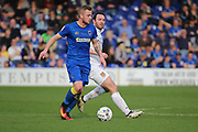 AFC Wimbledon midfielder Dean Parrett (18) dribbling during the EFL Sky Bet League 1 match between AFC Wimbledon and Northampton Town at the Cherry Red Records Stadium, Kingston, England on 11 March 2017. Photo by Matthew Redman.