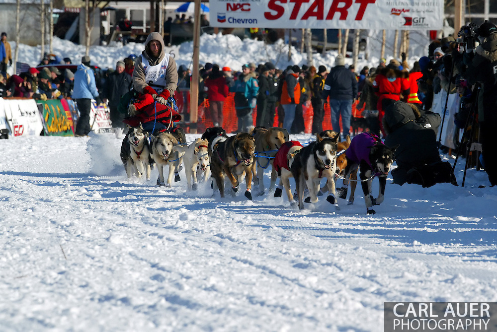 3/4/2007:  Willow, Alaska -  Right off of the start line, Veteran Sebastian Schnuelle of Whitehorse, YT CANADA makes some adjustments to his supplies in his sled at the start of the 35th Iditarod Sled Dog Race