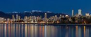 Panorama of Vancouver's English Bay and West End condo and apartment towers. The new Trump Tower and Living Shangri-La towers are the two taller skyscrapers on the right. Background mountain are Mount Bishop (left) and Mount Seymour. Photographed from Point Grey in Vancouver, British Columbia, Canada.