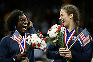 Adeline Gray (right) laughs with her new Olympic wrestling teammate, Tamyra Mensah, during the awards ceremony at the 2016 U.S. Olympic Trials in Carver-Hawkeye Arena in Iowa City, Iowa on Sunday, April 10, 2016. The three-time world champion hopes to become the first American female wrestler to win an Olympic gold medal in Rio this summer.