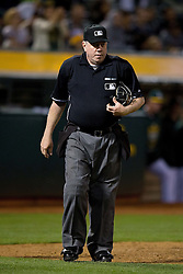 OAKLAND, CA - JUNE 17:  MLB umpire Brian Gorman #9 stands on the field during the eighth inning between the Oakland Athletics and the San Diego Padres at O.co Coliseum on June 17, 2015 in Oakland, California. The Oakland Athletics defeated the San Diego Padres 16-2. (Photo by Jason O. Watson/Getty Images) *** Local Caption *** Brian Gorman