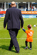 John Still , Manager of Luton Town takes a walk on the pitch with a young girl supporting an orrange t-shirt that reads 'Control the Controllables, John Still 2014' on its back ahead of the Skrill Conference Premier match at Kenilworth Road, Luton<br /> Picture by David Horn/Focus Images Ltd +44 7545 970036<br /> 21/04/2014