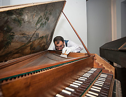 Conservator Jonathan Santa Maria Bouquet works on an ornate18th century harpsicord as part of the newly-refurbished St Cecilia's Hall, which has just undergone a 2 year, &pound;6.5 million refurbishment which will see more of the University of Edinburgh's musical instrument collection on display to the public.<br /> &copy; Dave Johnston/ EEm