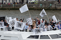 © Licensed to London News Pictures. 15/06/2016. LONDON, UK.  Vote Remain supporters on a boat on the River Thames near Westminster. Nigel Farage led a pro-Brexit flotilla of fishing vessels along the River Thames to Westminster today, urging people to vote leave in the European Referendum.  Photo credit: Vickie Flores/LNP