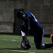 Wynel Seldon #31 of the Boston Brawlers kneels on the sideline prior to the first ever Boston Brawlers home game at Harvard Stadium on October 24, 2014 in Boston, Massachusetts. (Photo by Elan Kawesch)