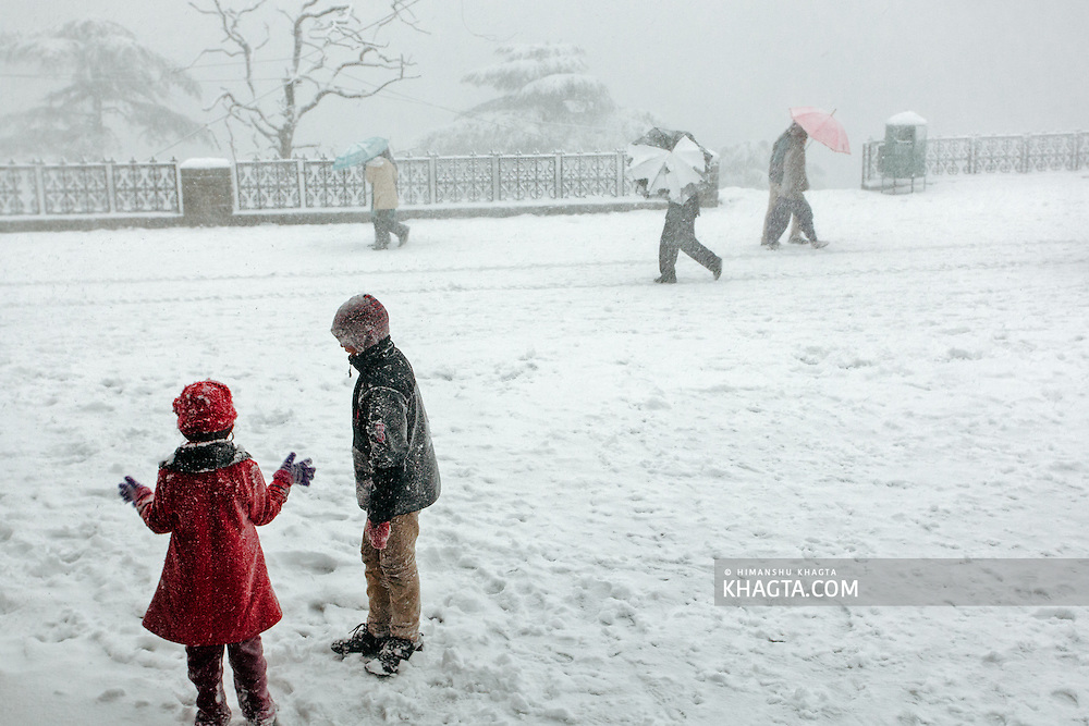 Kids enjoying snowfall at the Ridge, Shimla