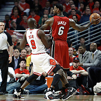 18 May 2011: Chicago Bulls small forward Luol Deng (9) defends on Miami Heat small forward LeBron James (6) during the Miami Heat 85-75 victory over the Chicago Bulls, during game 2 of the Eastern Conference finals at the United Center, Chicago, Illinois, USA.