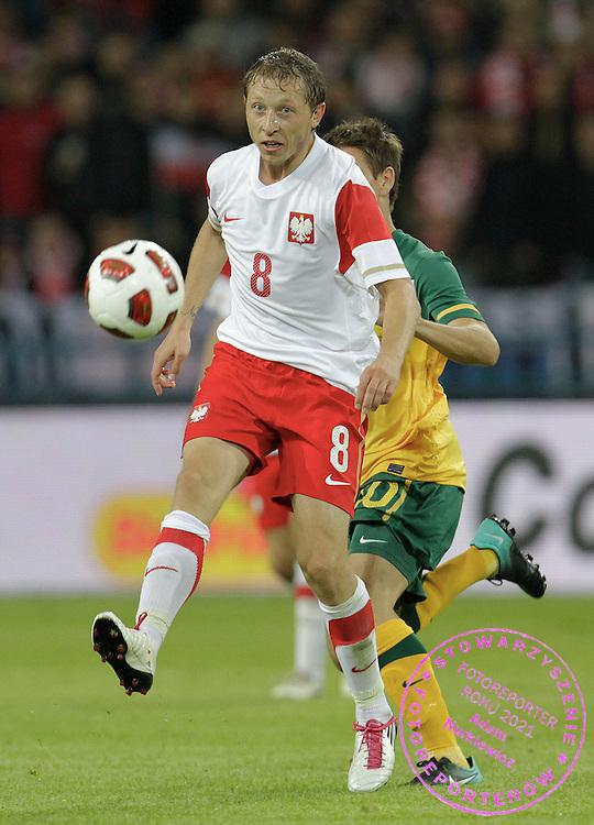 KRAKOW 07/09/2010.FOOTBALL INTERNATIONAL FRIENDLY.POLAND v AUSTRALIA.Rafal Murawski of Poland and Jon McKain of Australia ..Fot: Piotr Hawalej / WROFOTO