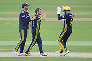 Liam Dawson, Tom Alsop and James Vince of Hampshire celebrate the wicket of George Scott during the Royal London One Day Cup match between Hampshire County Cricket Club and Middlesex County Cricket Club at the Ageas Bowl, Southampton, United Kingdom on 23 April 2019.