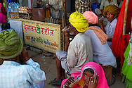 Some rajasthani people having tea in a busy Pushkar market during Pushkar Camel Fair, Rajasthan.