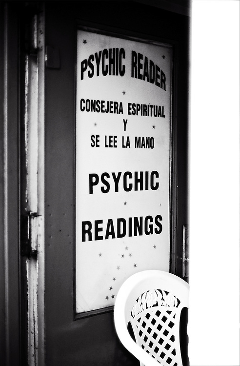 Plastic chair in front of door to psychic shop