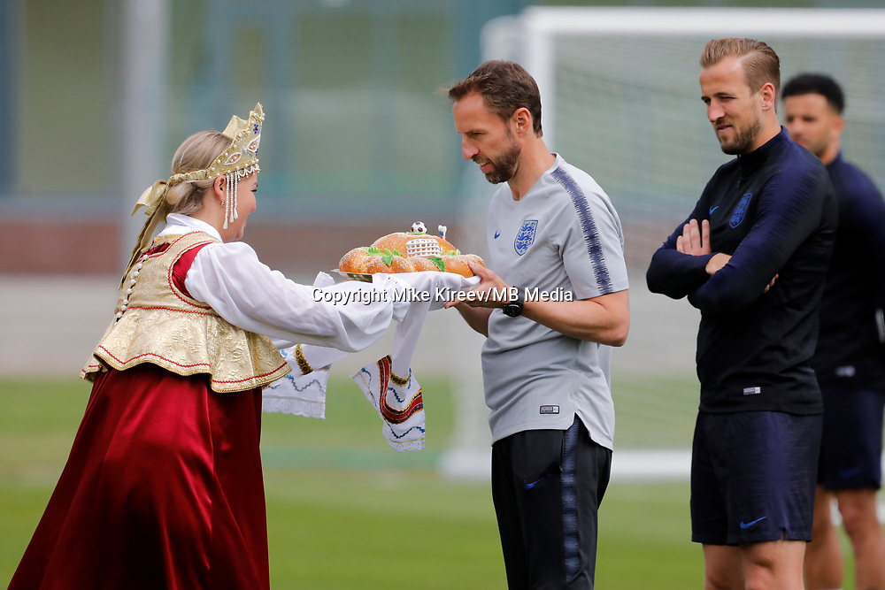 SAINT PETERSBURG, RUSSIA - JUNE 13: England national team head coach Gareth Southgate (C) and Harry Kane accept gifts before an England national team training session ahead of the FIFA World Cup 2018 in Russia at Stadium Spartak Zelenogorsk on June 13, 2018 in Saint Petersburg, Russia.