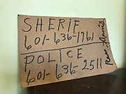 Double sided hand written sign on cardboard phone numbers dennis's and the sheriffs 8x13in<br />