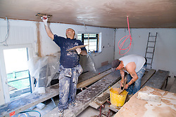 Men plastering the ceiling,