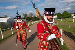© Licensed to London News Pictures. 15/05/2016. Windsor, UK. Two Beefeaters arrive for an evening event held at the Royal Windsor Horse show to celebrate the 90th birthday of HRH Queen Elizabeth II. Acts from arounds the world have been invited to perform at the evening event, set in the grounds of Windsor Castle. Photo credit: Ben Cawthra/LNP
