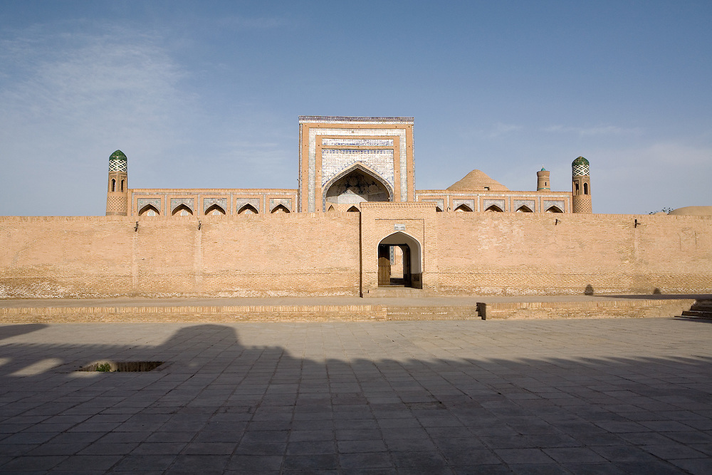 Looking toward a medrassa under shadow of ark fortress, Khiva