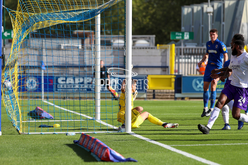 Ball hitting the back of the net after either an own goal or AFC Wimbledon striker Joe Pigott (39) scoring during the EFL Sky Bet League 1 match between AFC Wimbledon and Shrewsbury Town at the Cherry Red Records Stadium, Kingston, England on 14 September 2019.