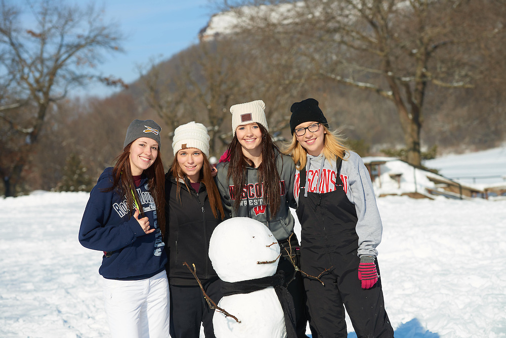 Activity; Sledding; Smiling; Socializing; Buildings; Bluffs; La Crosse; Trails; Location; Outside; Objects; People; Student Students; Woman Women; Type of Photography; Candid; Winter; February; UWL UW-L UW-La Crosse University of Wisconsin-La Crosse; Lifestyle
