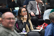 Judges of the 3 Minute Thesis Competition listen to presentations at the Stocker Center on February 15, 2017.