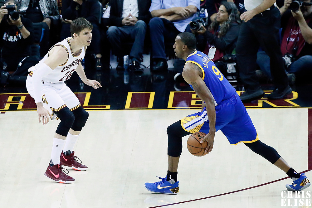 07 June 2017: Cleveland Cavaliers guard Kyle Korver (26) defends on Golden State Warriors forward Andre Iguodala (9) during the Golden State Warriors 118-113 victory over the Cleveland Cavaliers, in game 3 of the 2017 NBA Finals, at  the Quicken Loans Arena, Cleveland, Ohio, USA.