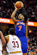Feb. 25, 2011; Cleveland, OH, USA; New York Knicks small forward Carmelo Anthony (7) shoots over Cleveland Cavaliers shooting guard Alonzo Gee (33) during the fourth quarter at Quicken Loans Arena. The Cavaliers beat the Knicks 115-109. Mandatory Credit: Jason Miller-US PRESSWIRE