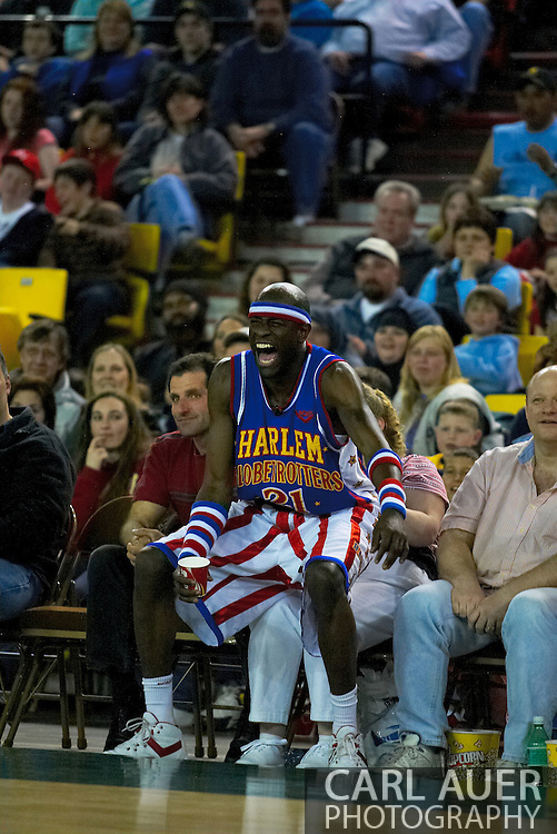 "05 May 2006: Kevin ""Special K"" Daley laughs it up while sitting on a fan to watch the Harlem Globetrotters vs the New York Nationals at the Sulivan Arena in Anchorage Alaska during their 80th Anniversary World Tour."