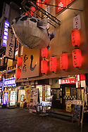 Fugu Restaurant in Dotombori - a district famous for its shops and restaurants and many neon and mechanized signs, including candy manufacturer Glico giant electronic display of a runner crossing the finish line, giant blowfish and other dramatic kitsch.