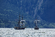 USA, Oregon, Hood River, windsurfers, and  Lady Washington and Hawaiian Chieftain of the Grays Harbor Historical Seaport Authority.