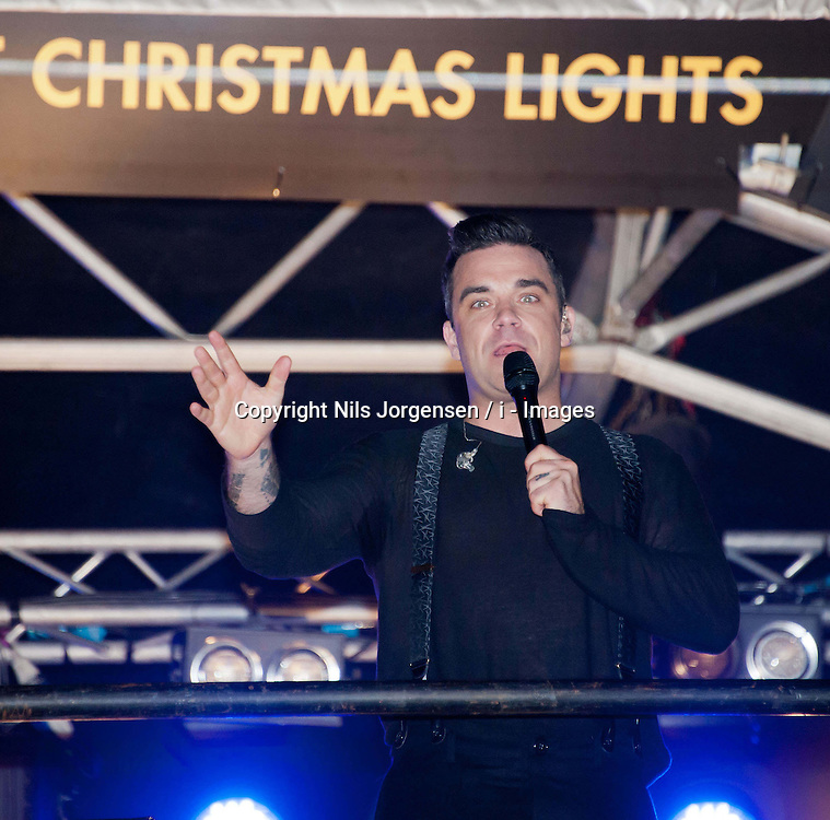 Robbie Williams, during the Marmite Oxford Street Christmas Lights switch-on.  Robbie Williams switches on this year's Christmas lights on the London High Street, hosted by House of Fraser with support from Lewis and boyband Lawson. Theakston and Bunton from Heart 106.2 present, Oxford Street, London, United Kingdom., Oxford Street, London, United Kingdom, November 5, 2012. Photo by Nils Jorgensen / i - Images.