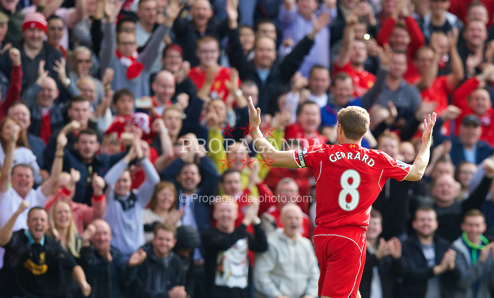 LIVERPOOL, ENGLAND - Saturday, September 27, 2014: Liverpool's captain Steven Gerrard celebrates scoring the first goal against Everton during the Premier League match at Anfield. (Pic by David Rawcliffe/Propaganda)