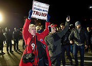 Nassau County Police stand guard as supporters for Republican Presidential candidate Donald J. Trump respond to protestors as they leave a rally for Trump at Grumman Studios on Wednesday, April 6, 2016, in Bethpage, N.Y. (AP Photo/Kathy Kmonicek)